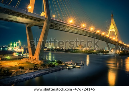 Bhumibol Bridge in Thailand at night, also known as the industrial ring road bridge.