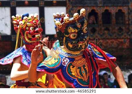 BHUTAN - APRIL 15: Dancers with colorful mask dance at a yearly festival called tsechu on April 15, 2008 in Bhutan