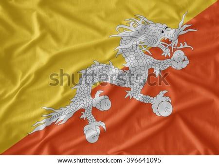 Bhutan  flag  on the fabric texture background - stock photo