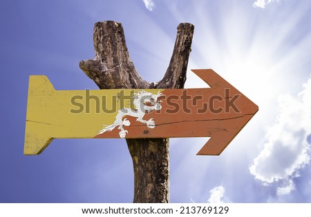 Bhutan wooden sign on a beautiful day - stock photo