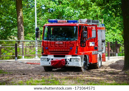 BIALYSTOK, POLAND - JULY 13: Iveco EuroCargo 120E Fire Truck while fetching water, on July 13, 2012 in Bialystok, Poland. Polish Fire Department.  - stock photo