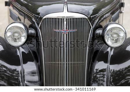 Biberach, Germany, 31 August 2015:: American vintage car, close-up of Chevrolet front detail - stock photo
