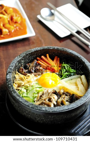 bibimbap in a heated stone bowl, korean dish - stock photo
