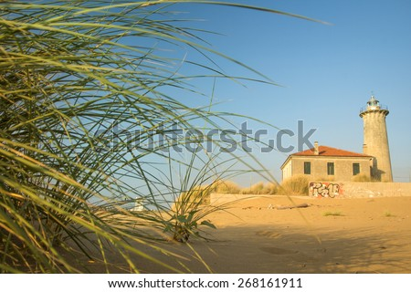 Bibione - The lighthouse on the beach at the mouth of the river Tagliamento - Veneto, Italy - stock photo