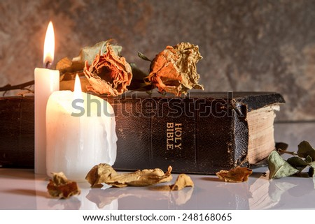 Bible and Candlelight, Open up your heart and invite Jesus into your life. - stock photo