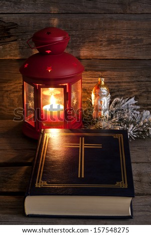 Bible and Christmas time abstract vintage  background in night with lantern and candlelight