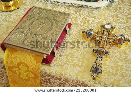 Bible and cross on the church table - stock photo
