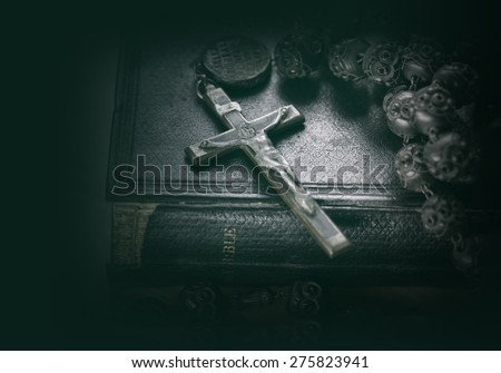 Bible and cross religious concept image - stock photo