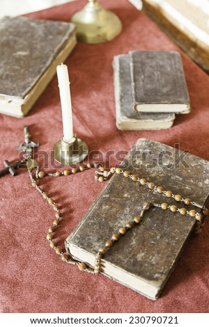 Bible and rosary to pray, detail of religious objects, Christianity, belief and faith - stock photo