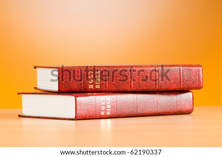 Bible books against the colorful gradient background - stock photo