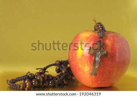 Bible Eva's Sin Red Apple over a Colored Background - stock photo