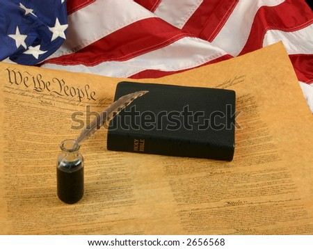 Bible, Flag, Inkwell with quill pen, and the United States Constitution - stock photo
