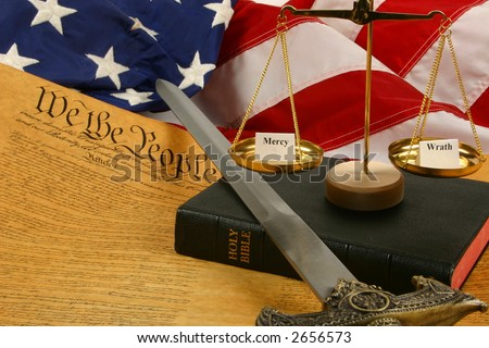 """Bible, Flag of the USA, Constitution, Candle, and Balance with """"Wrath"""" and """"Mercy"""" - stock photo"""