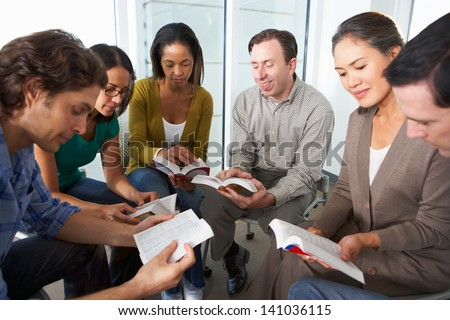 Bible Group Reading Together - stock photo