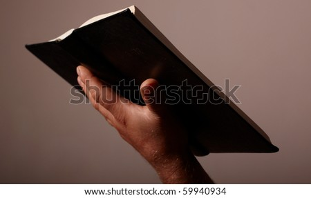bible in hand - stock photo