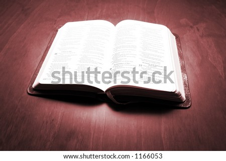 Bible in sepia on dark table - stock photo