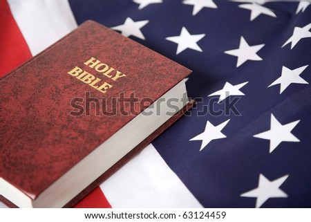 Bible laying on top of an american flag - stock photo
