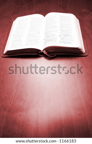 Bible on mahogany table - stock photo
