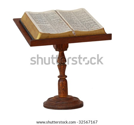 Bible on wooden stand isolated on white