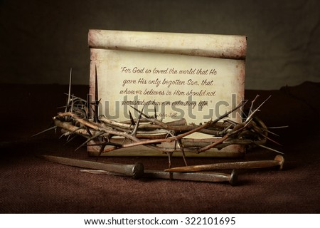 Bible Scripture with crown of thorns and nails over cloth - John 3:16 - stock photo