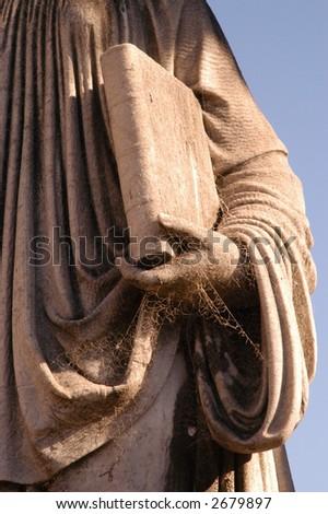 Bible Statue - stock photo