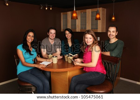 Bible Study with Diverse Group of Friends at a Cafe - stock photo
