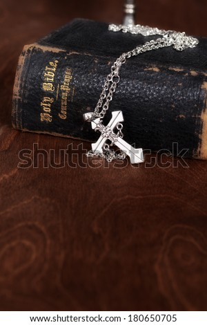 bible with silver cross - stock photo