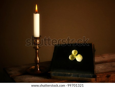 bibleor spiritual  book and candle, religious scripture lit by flame
