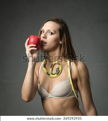 biblical character biting red apple, underwear outfit - stock photo