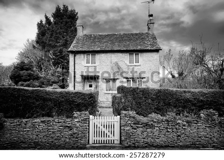 Bibury.Traditional Cotswold cottages in England, UK. Photo in Black and White style.