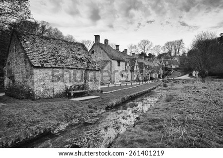 Bibury.Traditional Cotswold cottages in England, UK. Photo in Black and White style. - stock photo