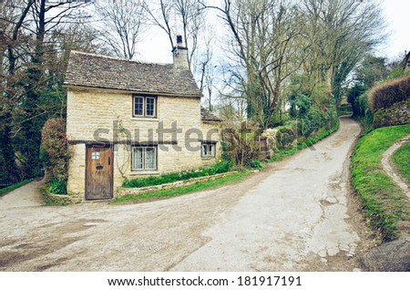 Bibury.Traditional Cotswold cottages in England, UK. Photo in vintage style. - stock photo