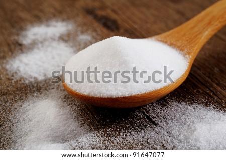 Bicarbonate in  wooden spoon - stock photo