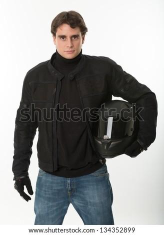 Bicker in black holding his crash helmet - stock photo