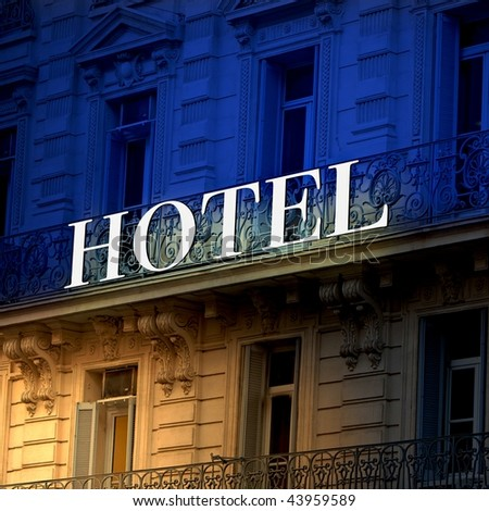 bicolor Illuminated  hotel sign - stock photo
