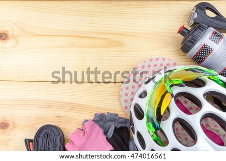 bicycle accessories isolated on wooden background