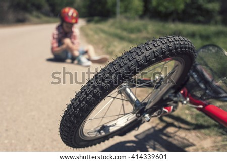 Bicycle accident. Kids safety concept. Selective focus toned image with shallow depth of field - stock photo