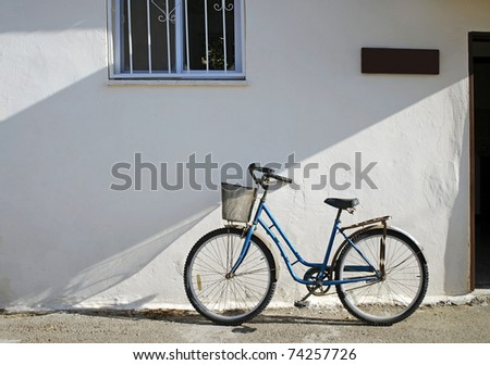 Bicycle against Stucco Building - stock photo