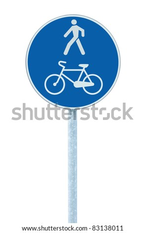 Bicycle and pedestrian lane road sign on pole post, large blue round isolated bike cycling and walking walkway footpath route traffic roadside signage - stock photo