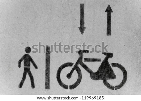 Bicycle and pedestrian road sign painted on the pavement. - stock photo