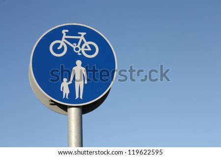 Bicycle and pedestrian shared route sign. - stock photo