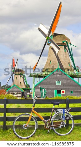 Bicycle and windmills in The Netherlands - stock photo
