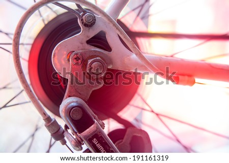 Bicycle back wheel spinning sprockets with chain and derailleur - stock photo
