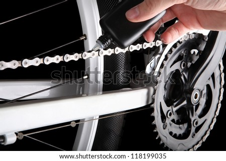 Bicycle chain oiling - stock photo