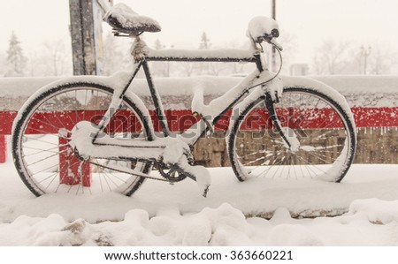 Bicycle covered with snow. - stock photo