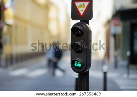 Bicycle crossing light in Paris, France - stock photo