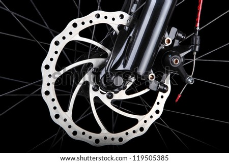 Bicycle disc brake on black background - stock photo
