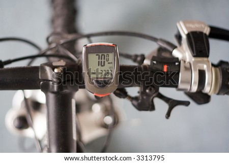 Bicycle handlebar with a speedometer with high speed in km/h. - stock photo