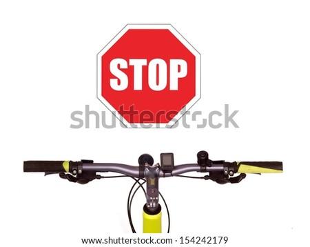 Bicycle handlebars isolated against a plain backgroubd - stock photo