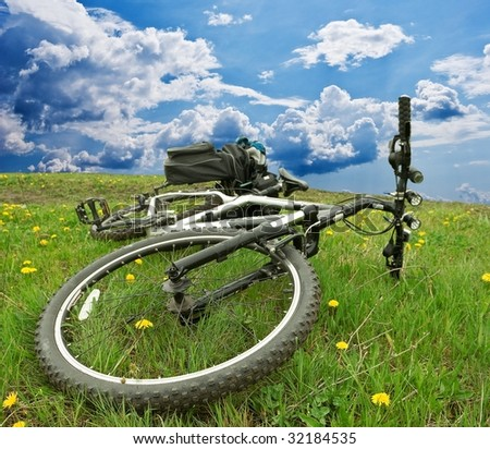 bicycle in a fields - stock photo